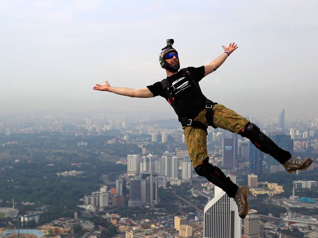 Those passed to take part were among a select group of less than 100 jumpers. (Photo by Lai Seng Sin/AP Photo)