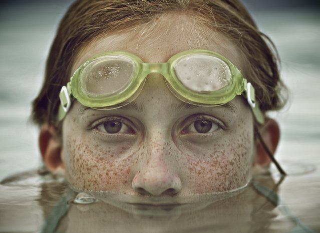 """When I'm Old..."" When I'm old and looking back on my daughter as a little girl, this is how I hope to remember her. The joy, the curious eyes, and the freckles that seem to go on forever. Photo location: Wilmington, NC. (Photo and caption by Mike Melnotte/National Geographic Photo Contest)"