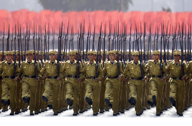 North Korean soldiers carrying guns march to mark the 60th anniversary of the signing of a truce in the 1950-1953 Korean War at Kim Il-sung Square, in Pyongyang, July 27, 2013. (Photo by Jason Lee/Reuters)