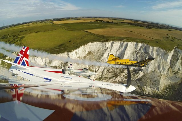In this handout image provided by Red Bull, Nigel Lamb and Paul Bonhomme of Great Britain fly in formation with Matthias Dolderer of Germany prior to the fifth stage of the Red Bull Air Race World Championship in front of the cliffs of Dover on August 14, 2014 near Dover, United Kingdom. (Photo by Balazs Gardi/Red Bull via Getty Images)
