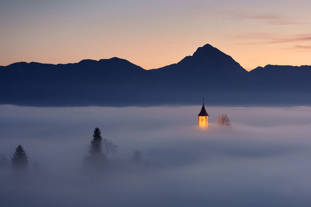 """Piece of Heaven: Jamnik, small village in Slovenia. One morning in in autumn, fog was just at the right height at the right time. The atmosphere was heavenly, unforgettable"". (Photo and comment by Janez Tolar/National Geographic Photo Contest via The Atlantic)"