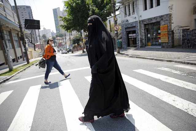 Gisele Marie, a Muslim woman and professional heavy metal musician, crosses a street after a rehearsal at a studio in Sao Paulo September 15, 2015. (Photo by Nacho Doce/Reuters)