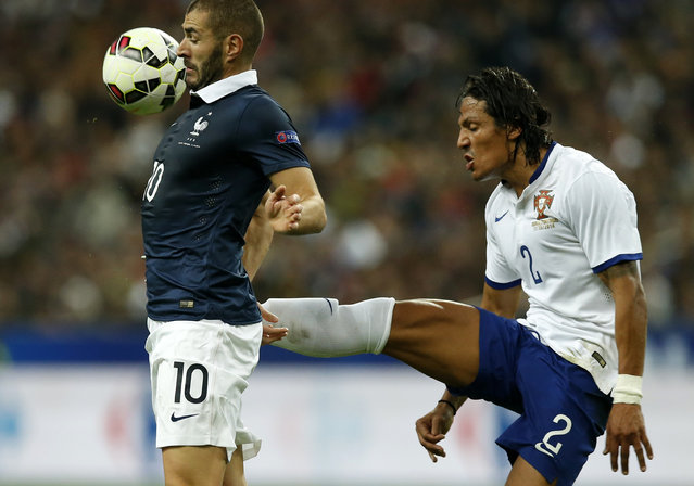 France's Karim Benzema (L) challenges Portugal's Bruno Alves (R) during their friendly soccer match at the Stade de France in Saint-Denis near Paris, October 11, 2014. (Photo by Benoit Tessier/Reuters)