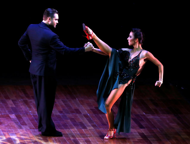 Dmitry Vasin and Sagdiana Khamzina, from Russia, perform their routine at the Stage style Tango World Championship, in Buenos Aires, Argentina, August 31, 2016. (Photo by Enrique Marcarian/Reuters)