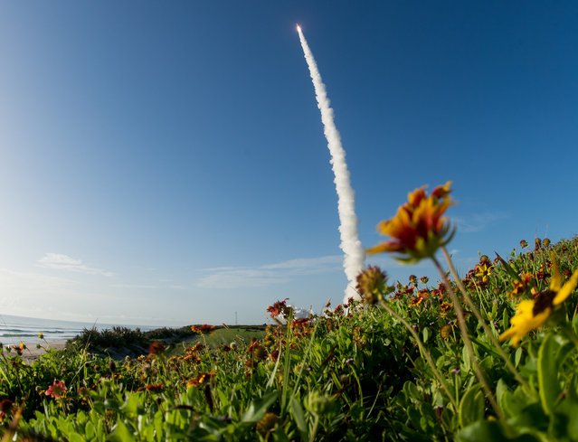 This NASA photo shows a United Launch Alliance Atlas V rocket with NASA's Mars 2020 Perseverance rover onboard as it launches from Space Launch Complex 41 at Cape Canaveral Air Force Station, on July 30, 2020, from NASA's Kennedy Space Center in Florida. The Perseverance rover is part of NASA's Mars Exploration Program, a long-term effort of robotic exploration of the Red Planet. (Photo by Joel Kowsky/NASA)