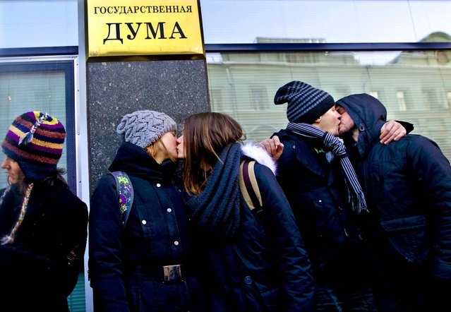 Gay rights supporters kiss each other during a protest outside of Russian Parliament lower in downtown Moscow, on January 22, 2013. A federal law banning homosexual propaganda was submitted to lawmakers late last year. (Photo by Ivan Sekretarev/Associated Press)
