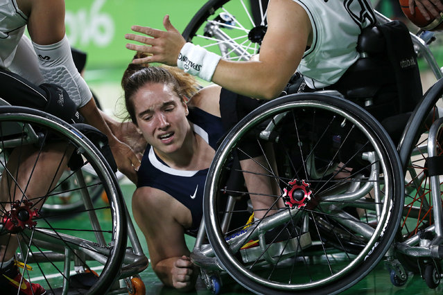 United States' Rebecca Murray falls during a women's gold medal wheelchair basketball game against Germany at the Paralympic Games in Rio de Janeiro, Brazil, Friday, September 16, 2016. United States won the gold. (Photo by Silvia Izquierdo/AP Photo)