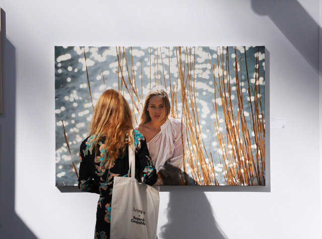 A woman looks at an artwork during the preview of the Art Paris 2020 held at the Grand Palais in Paris, France, September 9, 2020. Originally scheduled for April, Art Paris, France's second-biggest modern and contemporary art fair, opens its door to the public from Sept. 10 to 13. (Photo by Chine Nouvelle/SIPA Press/Rex Features/Shutterstock)