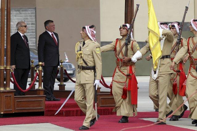 Jordan's King Abdullah (2nd L) and Tunisian President Beji Caid Essebsi (L) review an honour guard at Amman airport, Jordan, October 20, 2015. (Photo by Majed Jaber/Reuters)