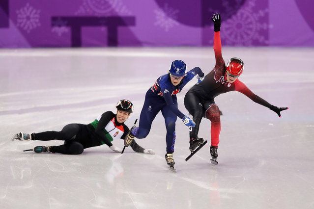 Elise Christie of Great Britain and Kim Boutin of Canada collide as Andrea Keszler of Hungary falls during the Ladies' 500m Short Track Speed Skating quarterfinal day four of the PyeongChang 2018 Winter Olympic Games at Gangneung Ice Arena on February 13, 2018 in Gangneung, South Korea. (Photo by Richard Heathcote/Getty Images)