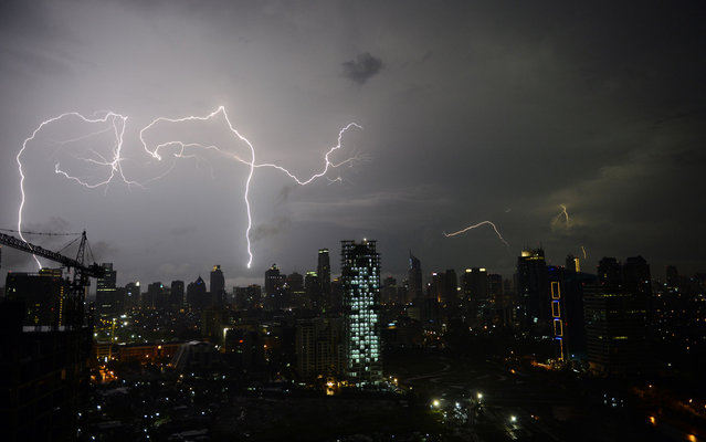 Lightnings sparkle in the sky of Jakarta, Indonesia – during a storm on March 4, 2013. (Photo by Romeo Gacad/AFP Photo)