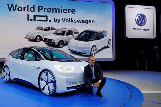 Herbert Diess, head of Volkswagen's namesake brand, poses in front of a Golf electric car on media day at the Mondial de l'Automobile, the Paris auto show, in Paris, France, September 29, 2016. (Photo by Jacky Naegelen/Reuters)