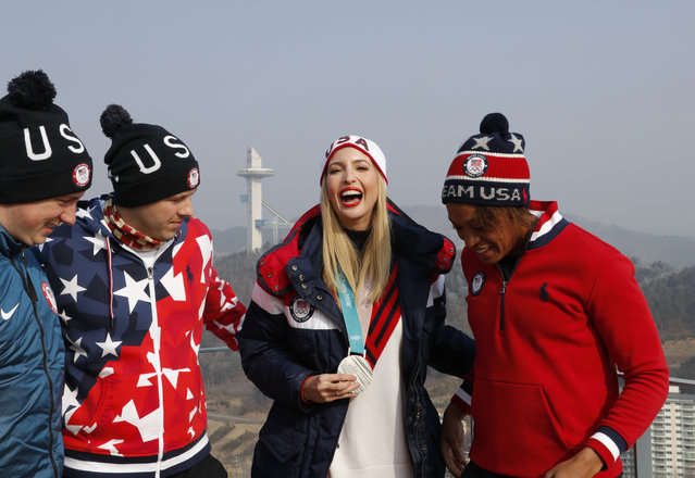 US President Donald Trump' s daughter and senior White House adviser Ivanka Trump (2nd R) poses for a photo on a balcony of the VIP tent at the Olympic sliding centre with US army luge athletes Taylor Morris (L) and Matt Mortensen (2nd L), and US women's bobsleigh silver medallist Lauren Gibbs (R) before the ski jump tower at the men' s four- man bobsleigh event of the Pyeongchang Winter Olympic games in Pyeongchang on February 25, 2018. (Photo by Eric Gaillard/Reuters)