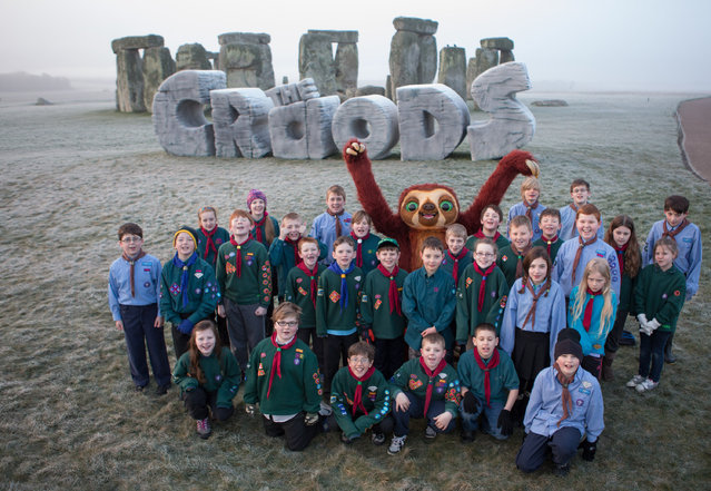 """19th March 2013: In celebration of the Spring Solstice 2013 and in conjunction with the release of Twentieth Century Fox's 3D animation 'THE CROODS' - a family animation centered around the first ever pre historic road trip - a giant monument was erected at Stonehenge at sunrise today, Tuesday 19th March.  This marks the first time a modern structure has EVER been allowed on this historic site. The Spring Solstice or 'Vernal Equinox' recognises the first day of spring and each year sees druids and pagans gather at Stonehenge early in the morning to watch the sun rise above the prehistoric stones.  This year an additional monument, in the shape of 'THE CROODS', will become part of these special celebrations at daybreak. 'Meet the first modern family, THE CROODS, whose world is rocked by generational clashes and seismic shifts that come to a head on a wild road trip filled with dazzling adventures, amazing firsts (like fire…and shoes), never before seen creatures and the epic discovery that they'll have to stay one step ahead of the ever-changing world or get left in the prehistoric dust.' DreamWorks Animation SKG presents THE CROODS. The film is directed by Chris Sanders & Kirk DeMicco, and produced by Kristine Belson and Jane Hartwell.  The screenplay is by Kirk DeMicco & Chris Sanders, with a story by John Cleese, Kirk DeMicco and Chris Sanders. The music is by Alan Silvestri. The film stars Nicolas Cage as Grug, Ryan Reynolds as Guy, Emma Stone as Eep, Catherine Keener as Ugga, Clark Duke as Thunk, and Cloris Leachman as Gran. THE CROODS presents an age known as the Croodaceous Period, which, says DeMicco, """"fell between the Jurassic Age and the 'Katzenzoic Era'– at least according to DreamWorks archaeologists."""" It is a world of visual splendor and grandeur that holds innumerable challenges for the beleaguered clan"""