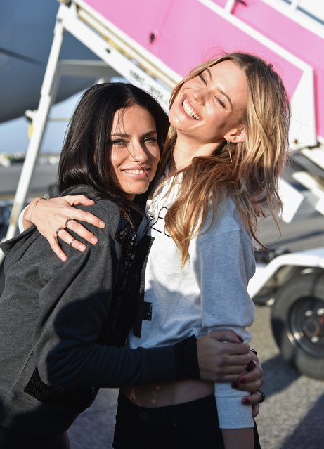 Victoria's Secret Models Adriana Lima (L) and Behati Prinsloo depart for London for the 2014 Victoria's Secret Fashion Show at JFK Airport on November 30, 2014 in New York City. (Photo by Mike Coppola/Getty Images for Victoria's Secret)