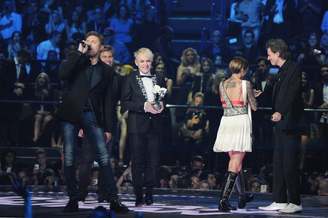 (L-R) Simon Le Bon, Roger Taylor, Nick Rhodes and John Taylor of Duran Duran receive the Video Visionary Award on stage during the MTV EMA's 2015 at the Mediolanum Forum on October 25, 2015 in Milan, Italy. (Photo by Brian Rasic/Getty Images for MTV)