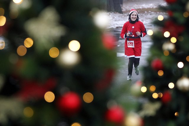 "A costumed participant attends the ""Santa Claus Run"" in Mogosoaia, near Bucharest December 6, 2014. (Photo by Bogdan Cristel/Reuters)"