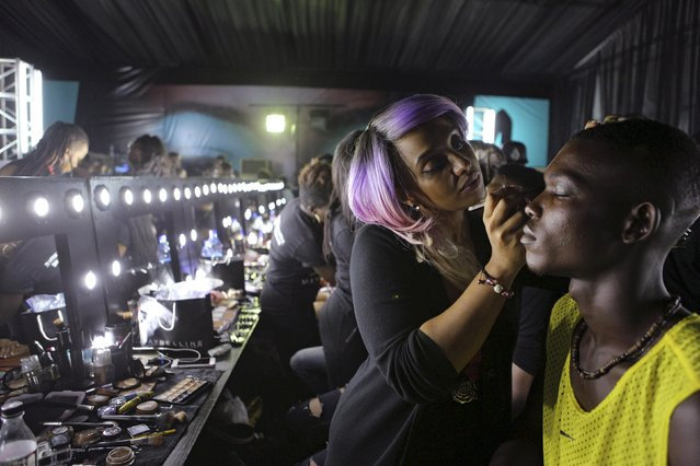 A make-up artist applies make-up to a model backstage at Lagos Fashion and Design Week in Lagos, Nigeria, October 29, 2015. (Photo by Joe Penney/Reuters)
