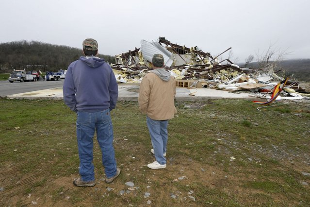 Larry Gammill, left, and Tim Parks survey tornado damage at Botkinburg Foursquare Church in Botkinburg, Ark., Thursday, April 11, 2013, after a severe storm struck the building late Wednesday. The National Weather Service is surveying areas Thursday to determine whether tornadoes or strong winds caused damage. (Photo by Danny Johnston/AP Photo)
