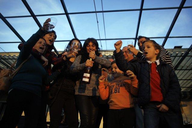 "Winners of Spain's Christmas Lottery ""El Gordo"" celebrate in Arriate, near Malaga, southern Spain December 22, 2014. (Photo by Jon Nazca/Reuters)"