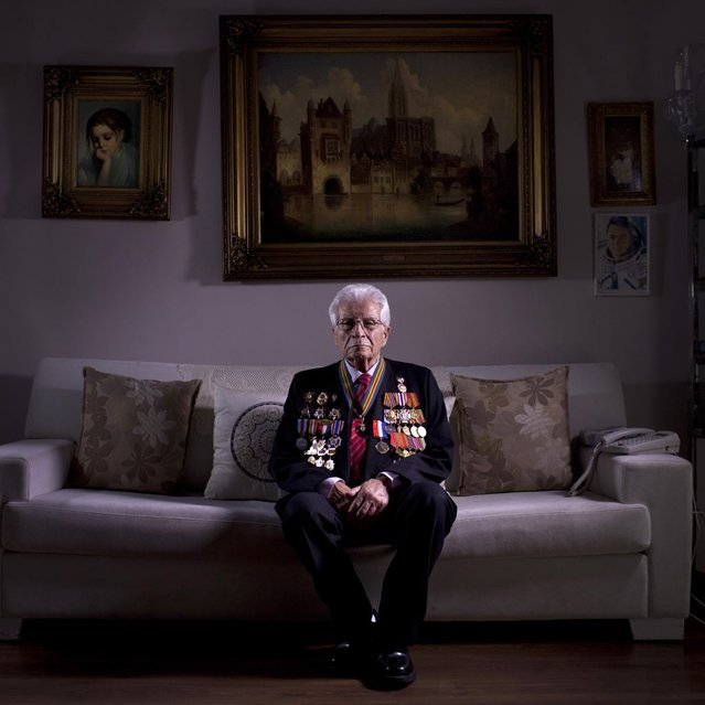 In this photo made Wednesday, April 10, 2013, Soviet Jewish World War Two veteran Shalom Skopes, 88, poses for a portrait at his house in Tel Aviv Israel. Skopes was a battalion commander in the Red Army, and fought in Latvia. During a battle he was injured by a hand grenade and was hospitalized until May 25, 1945, when Skopes demobilized in 1947 and immigrated to Israel in 1959. About 500,000 Soviet Jews served in the Red Army during World War Two, and the majority of those still alive today live in Israel. (Photo by Oded Balilty/AP Photo)