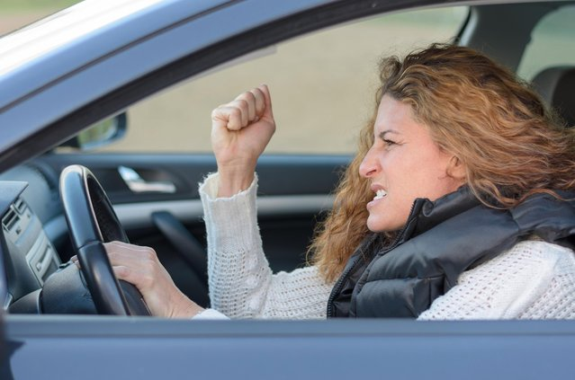 Frustrated woman driving car. (Photo by Michael Heim/EyeEm/Getty Images)