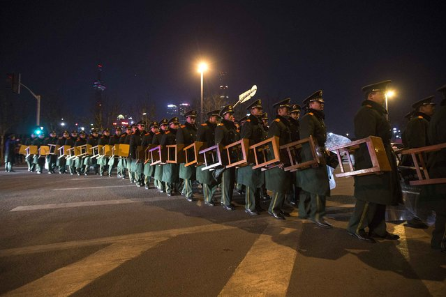 Paramilitary police officers walk on the location where people were killed in a stampede incident during a New Year's celebration on the Bund in Shanghai January 1, 2015. (Photo by Aly Song/Reuters)