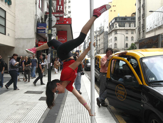 Mariela Duffoo, from Peru, performs a pole dancing routine to promote the Miss Pole Dance South America 2012 competition in Buenos Aires November 23, 2012. (Photo by Enrique Marcarian/Reuters)