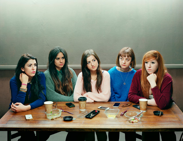 Five Girls, 2014, by David Stewart – the 2015 winner. This group portrait of Stewart's daughter and four friends mirrors a shot he took of them seven years ago, which featured in the Taylor Wessing 2008 show. In the original, the friends were about to start their GCSEs. Here, they have just graduated from university. (Photo by David Stewart/Taylor Wessing Portrait Prize 2015)