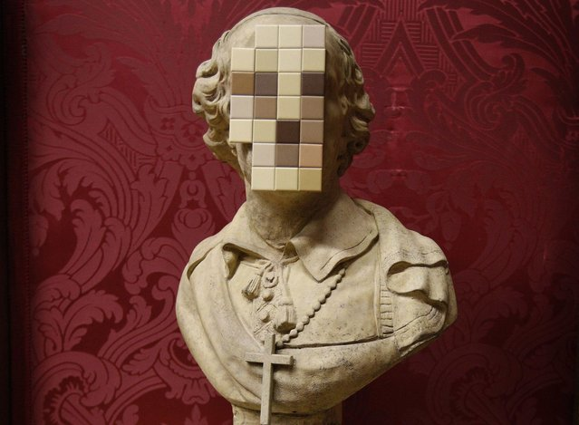 """Cardinal Sin"" a new work by British artist Banksy is unveiled at the Walker Art Gallery in Liverpool Liverpool, northern England December 16, 2011. The piece made up of an 18th century replica stone bust of a cardinal with the face sawn off and replaced with a mosaic of bathroom tiles is thought to be a comment on the abuse scandal in the church and its subsequent cover-up, the gallery said in a press release. (Photo by Phil Noble/Reuters)"