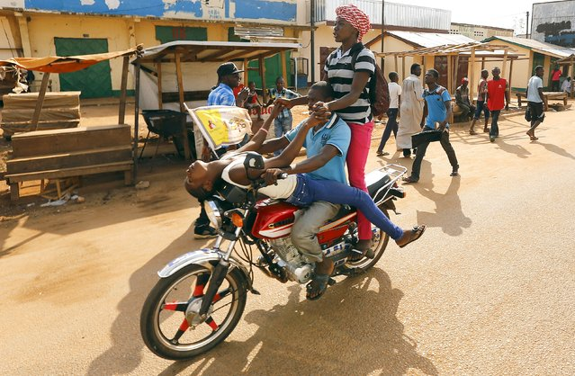 People ride a motorcycle near Koudoukou Mosque where Pope Francis meets with the Imam Tidiani Moussa Naibi in Bangui, Central African Republic, November 30, 2015. (Photo by Stefano Rellandini/Reuters)