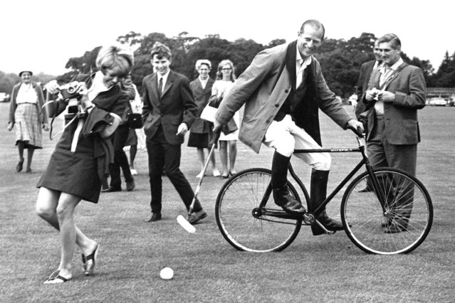Prince Philip, Duke of Edinburgh practicing his bicycle polo technique, Windsor Great Park, Berkshire, 1964. (Photo by Norman Potter/Daily Express/Hulton Archive/Getty Images)