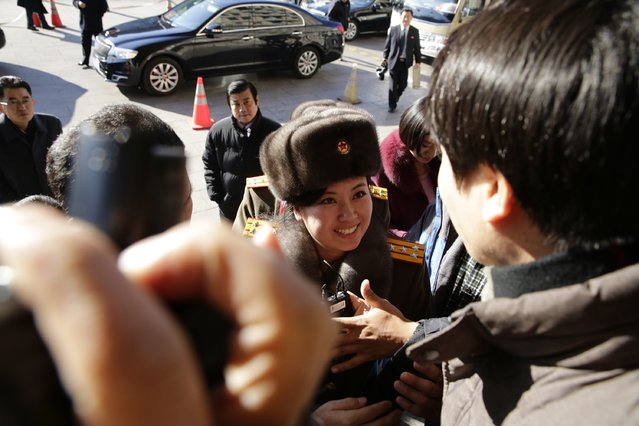 Members of the North Korean female music group Moranbong Band arrive at a hotel after concert rehearsal on December 11, 2015 in Beijing, China. The Moranbong Band will perform at the National Centre for the Performing Arts from December 12 to 14. (Photo by ChinaFotoPress/ChinaFotoPress via Getty Images)