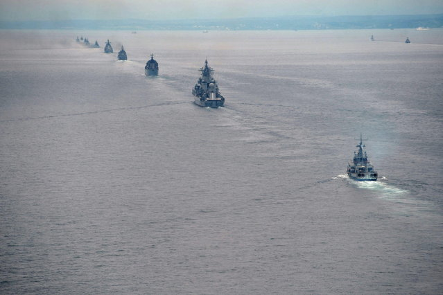 Russian Pacific Navy ships sail near the Sakhalin Island during military exercises on Tuesday, July 16, 2013. (Photo by Alexei Nikolsky/AP Photo/RIA Novosti/Presidential Press Service)