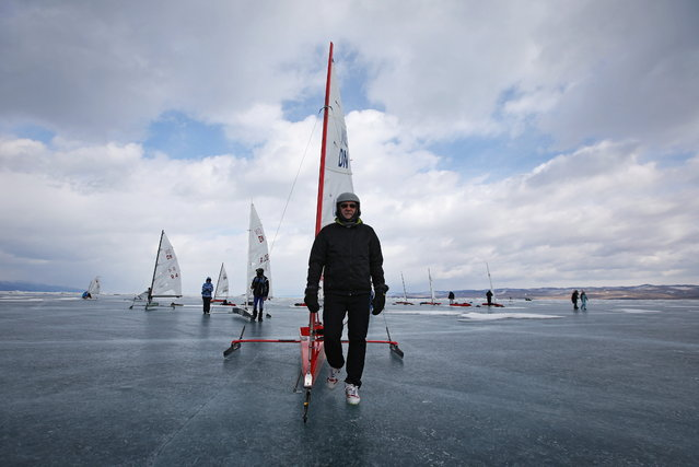 Participants compete on the ice of frozen Lake Baikal during the Baikal ice sailing cup in Irkutsk Region, Russia on March 23, 2021. (Photo by Yuri Novikov/Reuters)
