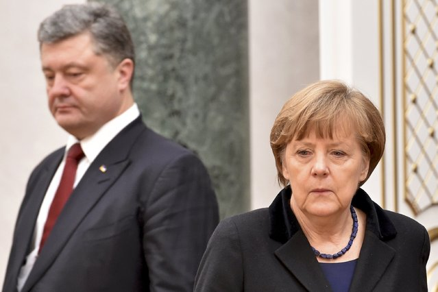 Ukraine's President Petro Poroshenko (L) and Germany's Chancellor Angela Merkel take part in peace talks on resolving the Ukrainian crisis in Minsk, February 11, 2015. (Photo by Kirill Kudryavtsev/Reuters)