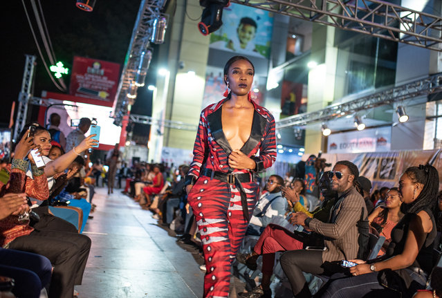 Action on the catwalk during the Congo fashion week. (Photo by Olivia Acland/The Guardian)