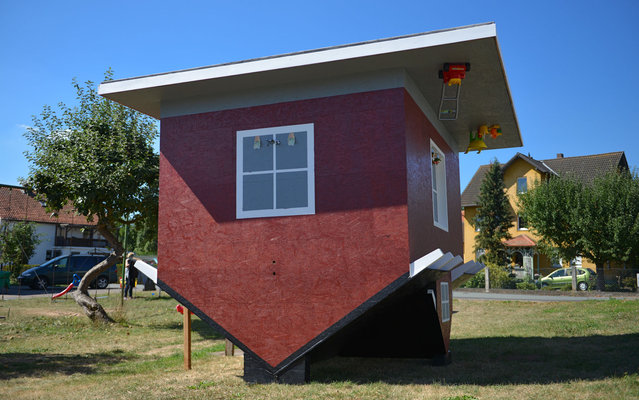 An upside down model of a house is build in Wellen, central Germany, on September 5, 2013.  A full scaled house will be erected 2014 at the Edersee, central Germany. (Photo by Uwe Zucchi/AFP Photo/DPA)