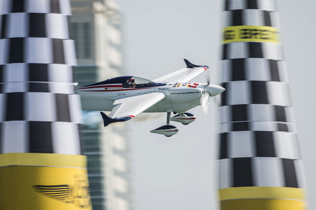 In this photo provided by Naim Chidiac via Global-Newsroom, Matthias Dolderer of Germany performs during the qualifying of the first stage of the Red Bull Air Race World Championship in Abu Dhabi, United Arab Emirates, Friday, February 13, 2015. (Photo by Naim Chidiac/AP Photo/Global-Newsroom)