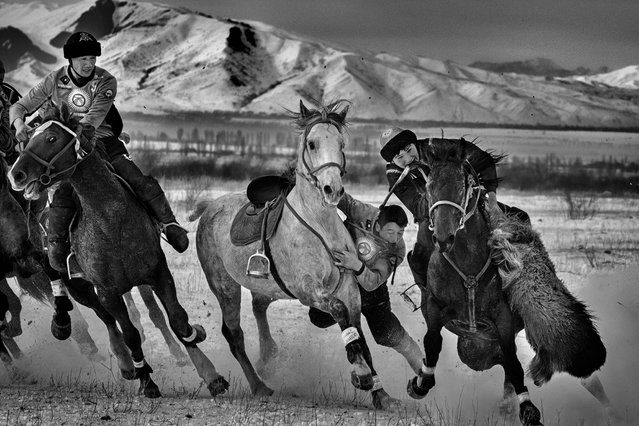 Sports Story First Prize. A game of Kok Boru, the national sport, in the village of Sovietkoe,40 km from Karakol in Kyrgyzstan. (Photo by Alain Schroeder/Istanbul Photo Awards 2021)
