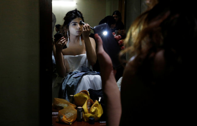 A contestant prepares at the backstage before the Miss Transqueen India 2018 transgender beauty pageant in Mumbai, India on October 7, 2018. (Photo by Francis Mascarenhas/Reuters)