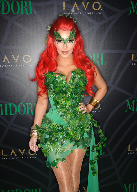 Kim Kardashion attends the Midori Green Halloween costume party at Lavo on October 29, 2011 in New York City. (Photo by Dave Kotinsky/Getty Images)