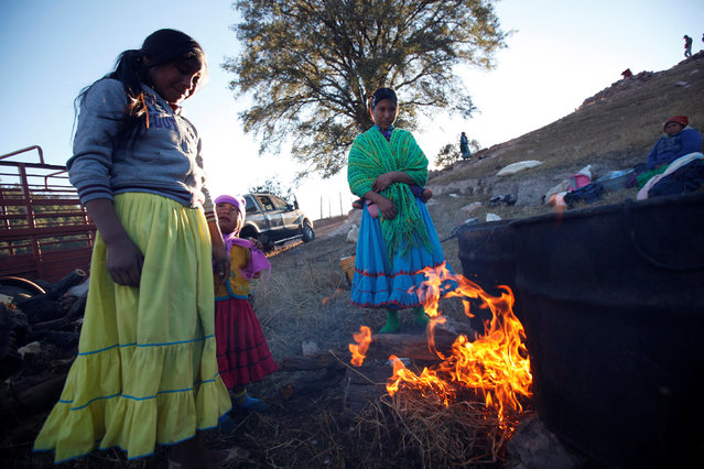 Women from the Tarahumara ethnic group keep warm by the fire while preparing for winter in Caborachi village, in Guachochi, Mexico, December 17, 2016. (Photo by Jose Luis Gonzalez/Reuters)