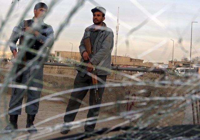 Afghan policemen are seen through a cracked window of a vehicle at the site of a suicide attack in Kabul March 25, 2015. (Photo by Omar Sobhani/Reuters)