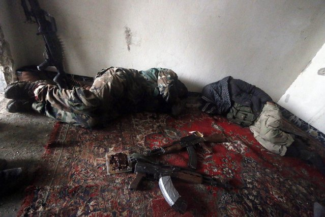 Rebel fighters sleep inside a room at al-Breij frontline, after what they said was an advance by them in the area and they took control of 2 factories and several buildings where forces loyal to Syria's President Bashar al-Assad were stationed, in Aleppo January 5, 2015. (Photo by Hosam Katan/Reuters)