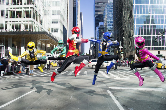 The Power Rangers Super Megaforce show off their Ranger moves during the 87th Annual Macy's Thanksgiving Day Parade on Thursday, November 28, 2013, in New York. (Photo by Charles Sykes/AP Images/Invision for Saban Brands)