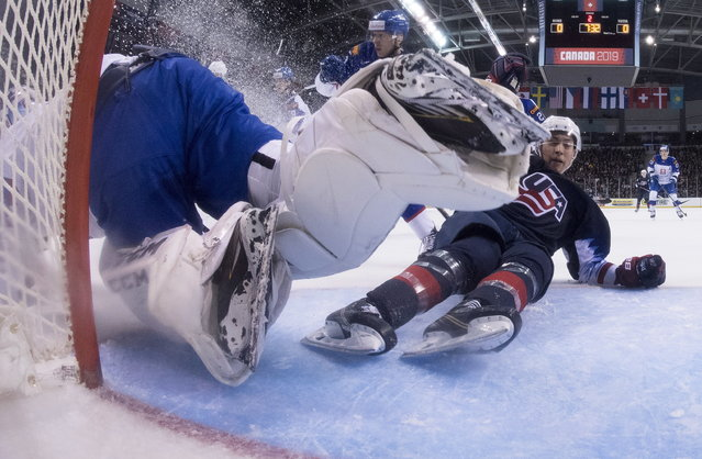 United States' Jason Robertson crashes into Slovakia goaltender Samuel Hlavaj during the second period in a world junior men's hockey championship game in Victoria, British Columbia, Wednesday, December 26, 2018. (Photo by Jonathan Hayward/The Canadian Press via AP Photo)