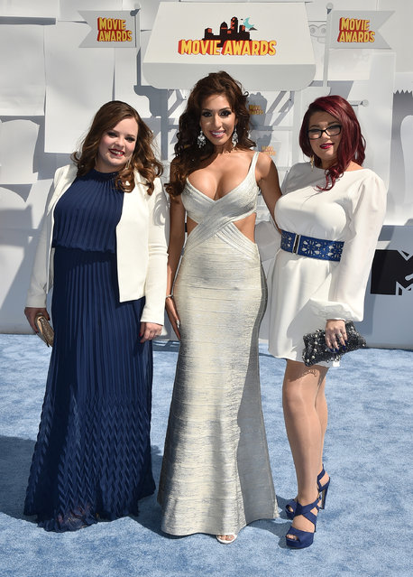 Catelynn Lowell, from left, Farrah Abraham, and Amber Portwood arrive at the MTV Movie Awards at the Nokia Theatre on Sunday, April 12, 2015, in Los Angeles. (Photo by Jordan Strauss/Invision/AP Photo)