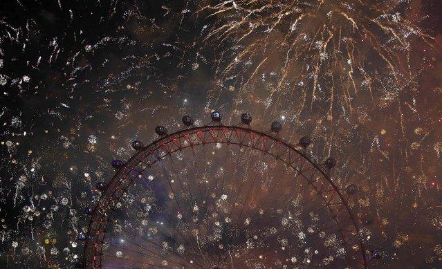 Fireworks explode across the London skyline near the London Eye. (Photo by Olivia Harris/Reuters)