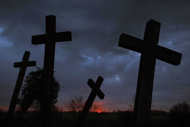Crosses at a war memorial stand in front of the dawning sky at Muhi, 167 kms northeast of Budapest, Hungary, on Easter Sunday, April 5, 2015. (Photo by Zsolt Czegledi/AP Photo/MTI)